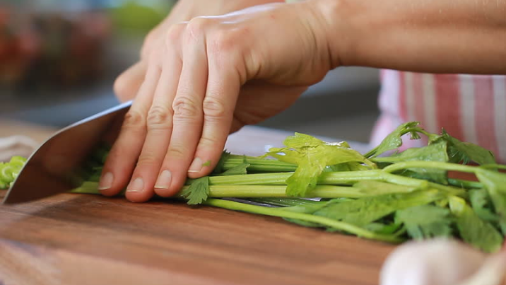 Chopping celery for chicken noodle soup recipe