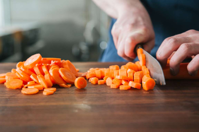 chopping carrots for chicken noodle soup recipe