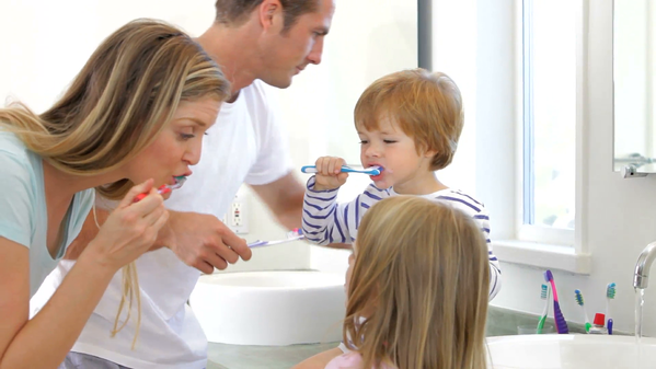 Brush your teeth together with your child