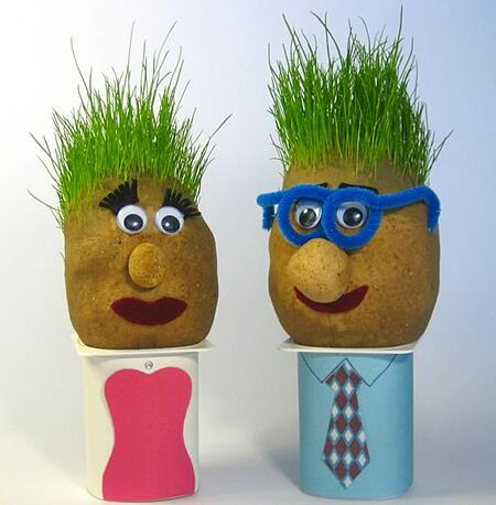 Making grass heads helps build fine motor skills
