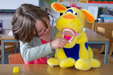 Encourage your child to brush their favourite teddy or toy's teeth.